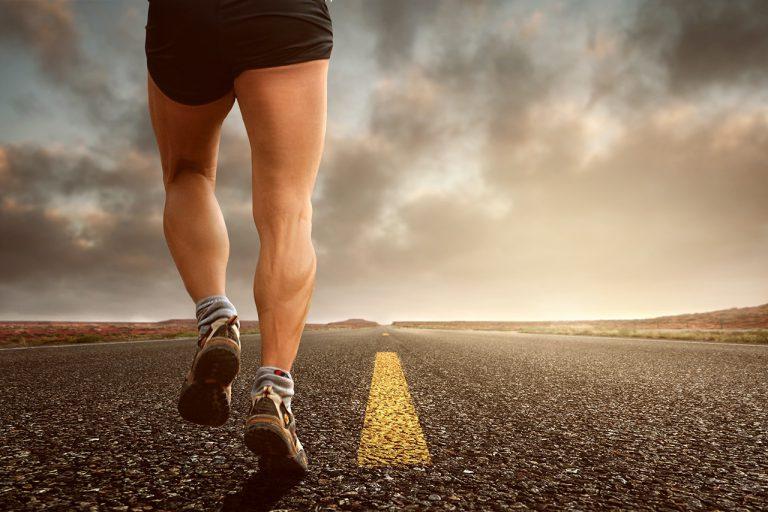 men running on a road
